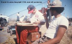 Laguna Seca 1973 Troy Rogers, Chaparral mechanic w/Kenneth looking at Chaparral scrapbook