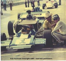 Gus Hutchison and David Brown(crew chief) checking out David Hobbs Lola circa 1972
